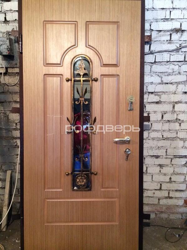 металлические остеклённые двери с кованными элементами